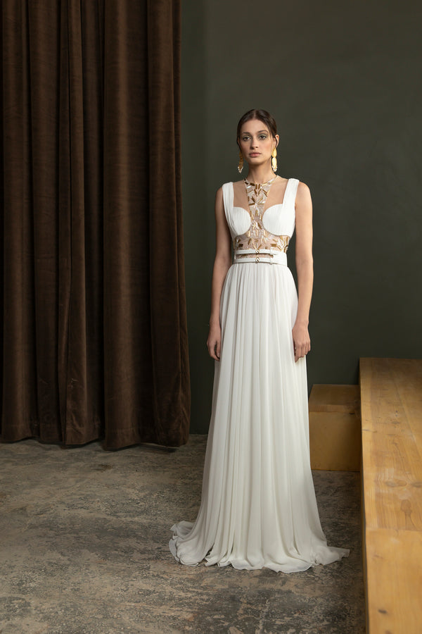 Long beaded,	crepe georgette dress with a wide leather belt