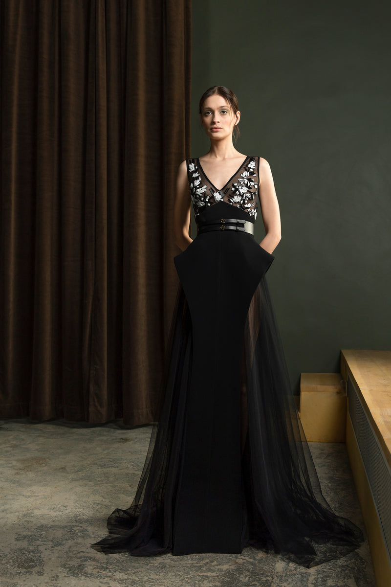 Long sleeveless beaded, tulle dress with a	wide leather belt
