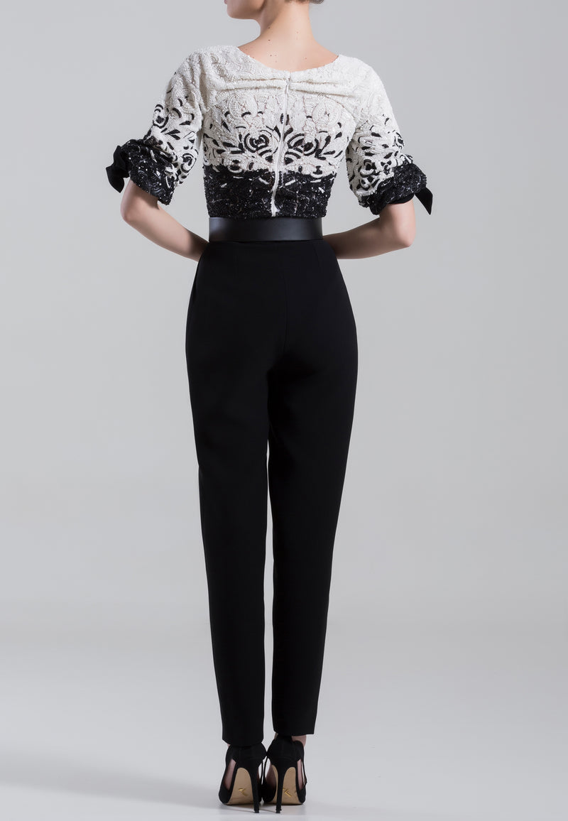 Fully beaded bodysuit and classic crepe pants	with	 straight	legs, with a wide leather belt