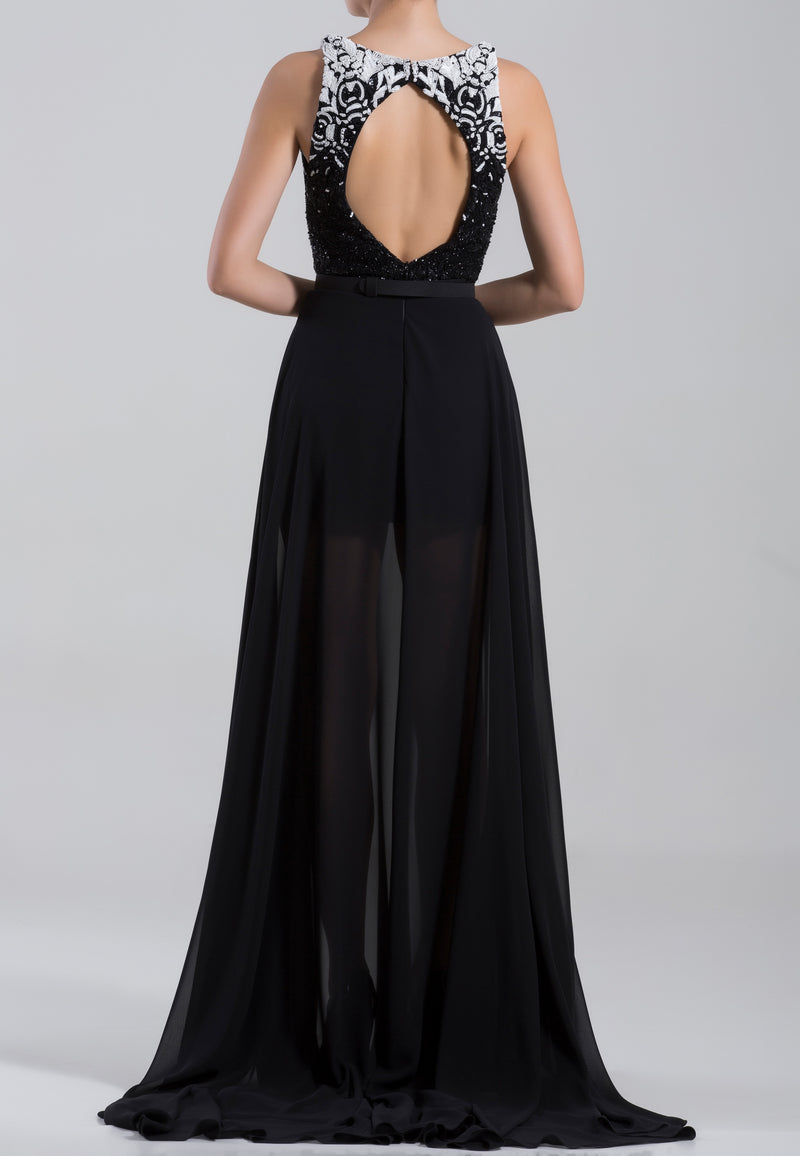 Long beaded,	sleeveless crepe georgette dress with a thin belt
