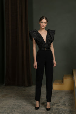 Brocade	bodysuit	and	classic crepe pants with a wide  leather belt