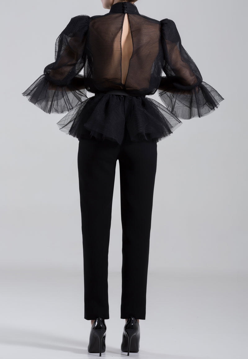 Tulle blouse and classic crepe pants with	a thin belt