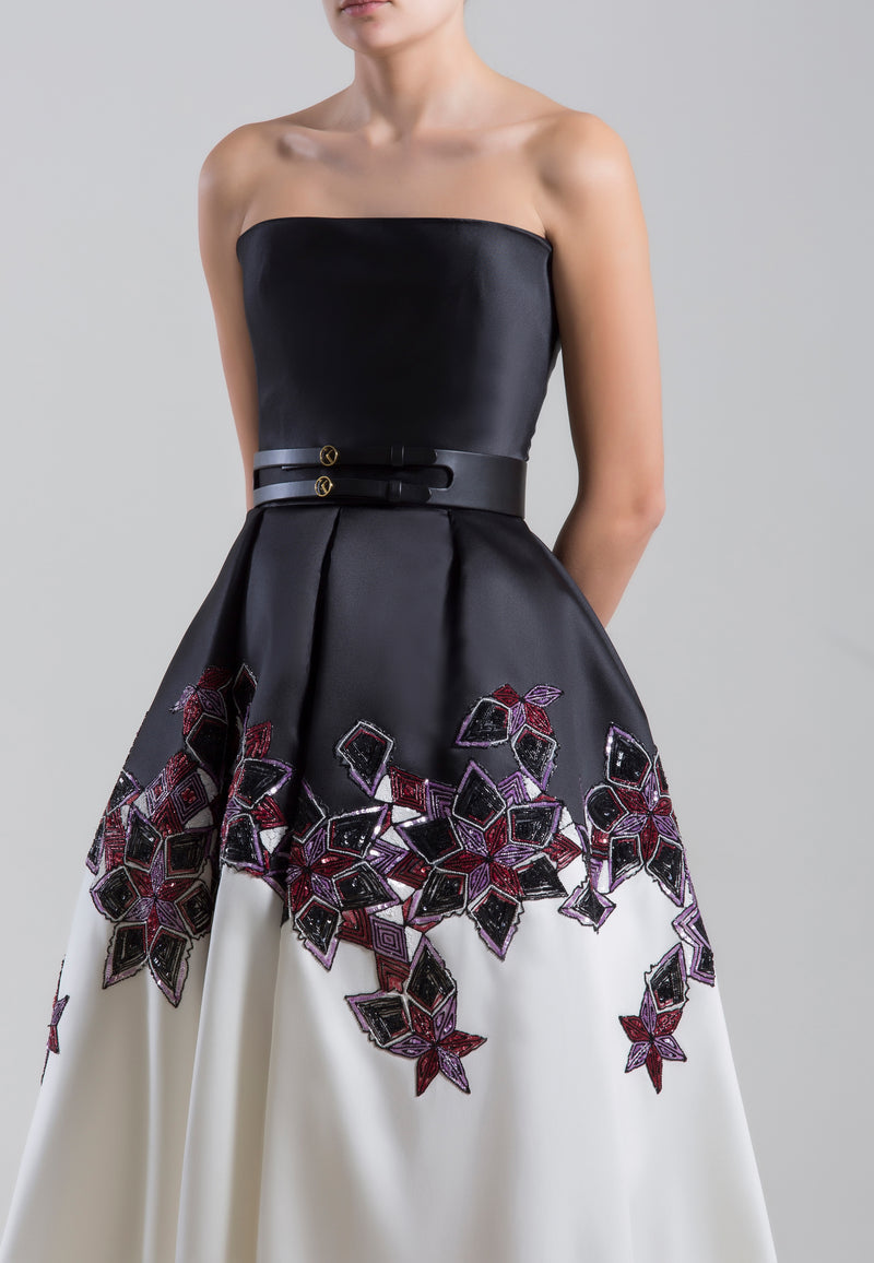 Long strapless beaded	mikado dress	with	a wide leather belt