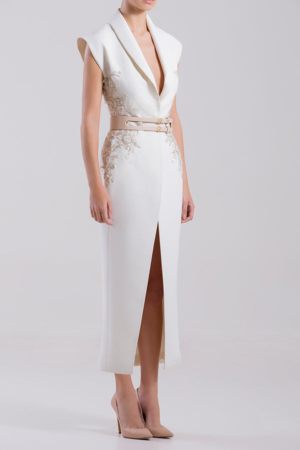 """Pearled Ivory crepe marocain dress with a tailored collar and side beige ivory flower beading, paired with a signature ivory leather belt. """