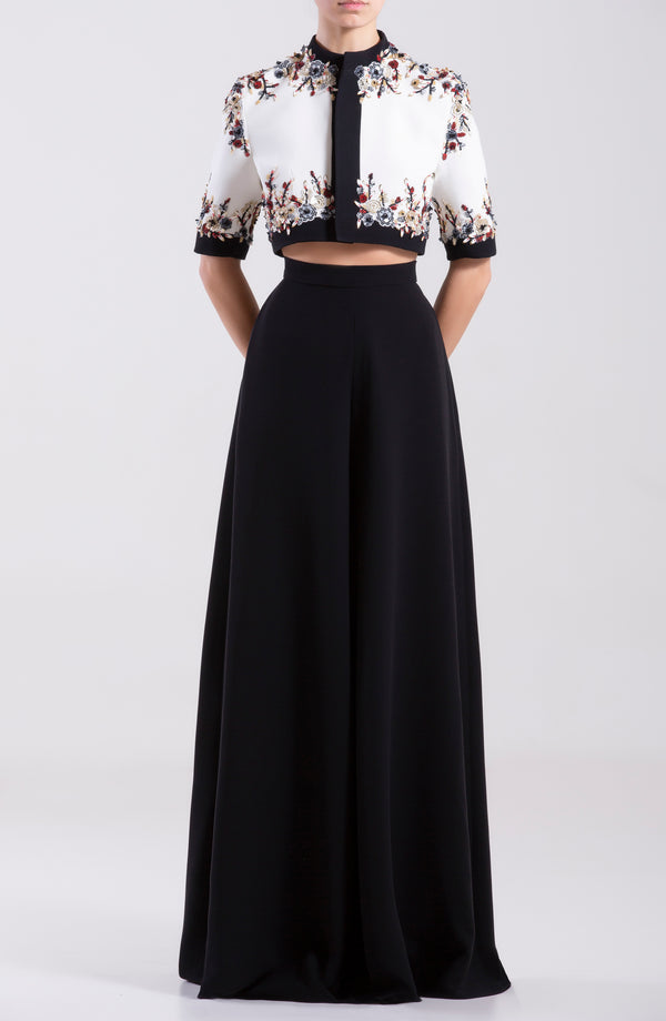 Waist length mini jacket with flower beaded sleeves and bodice, paired with wide crepe georgette pants.