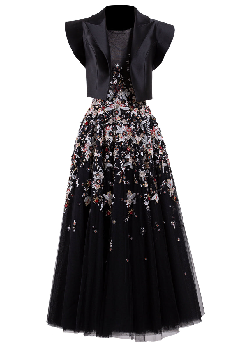 Sleeveless beaded tulle dress paired with a waist length black Mikado jacket.