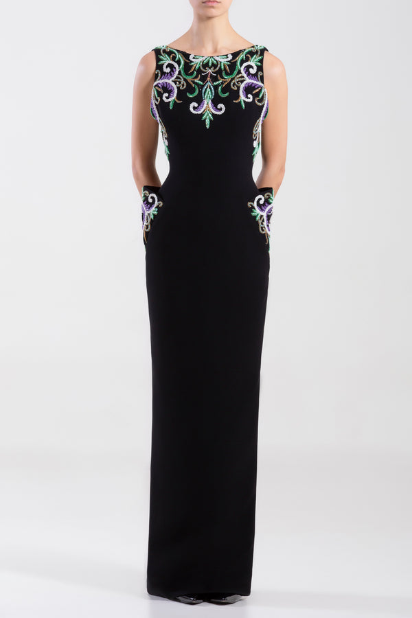 Crepe marocain, sleeveless dress with a beaded top ad side pockets.