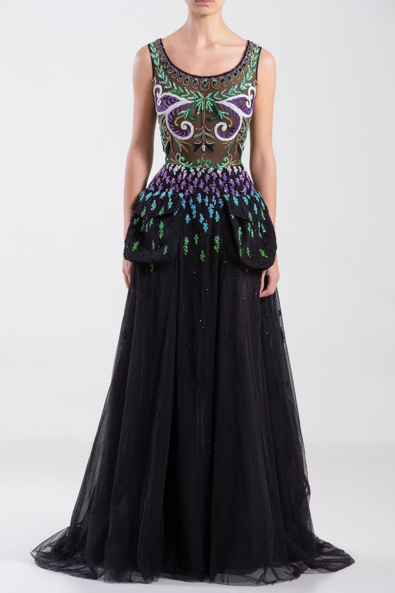 Long sleeveless tulle dress with a beaded top and pockets.
