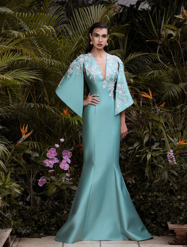 Mikado Blue Tint mermaid dress with a flared embroidered cape.