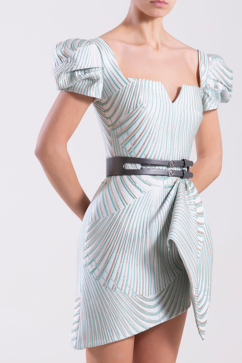 Short Brocade Blue Tint dress with a side ruffle and pleated short sleeves, paired with a signature metallic grey leather belt.