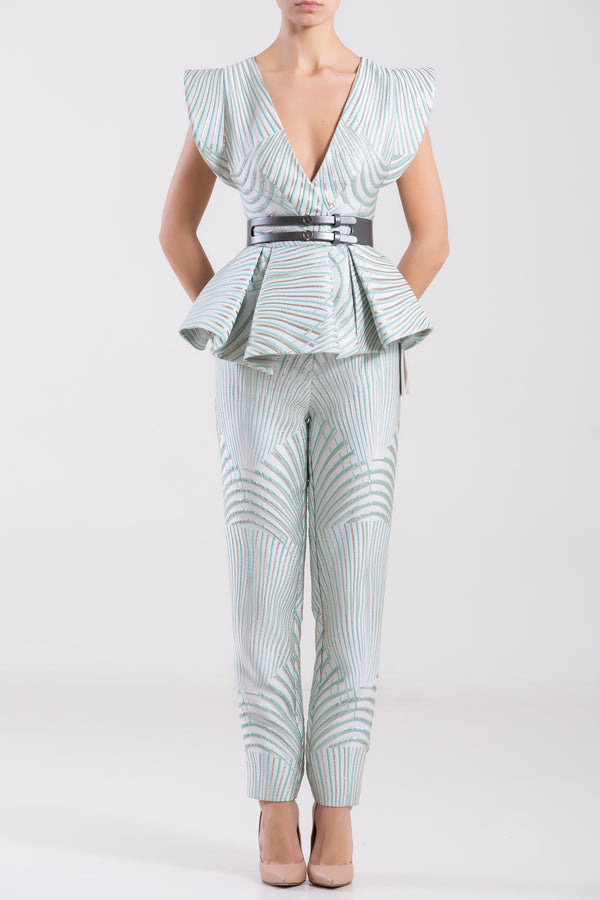 Brocade Blue Tint pleated top with matching fitted pants, paired with a metallic grey leather belt.
