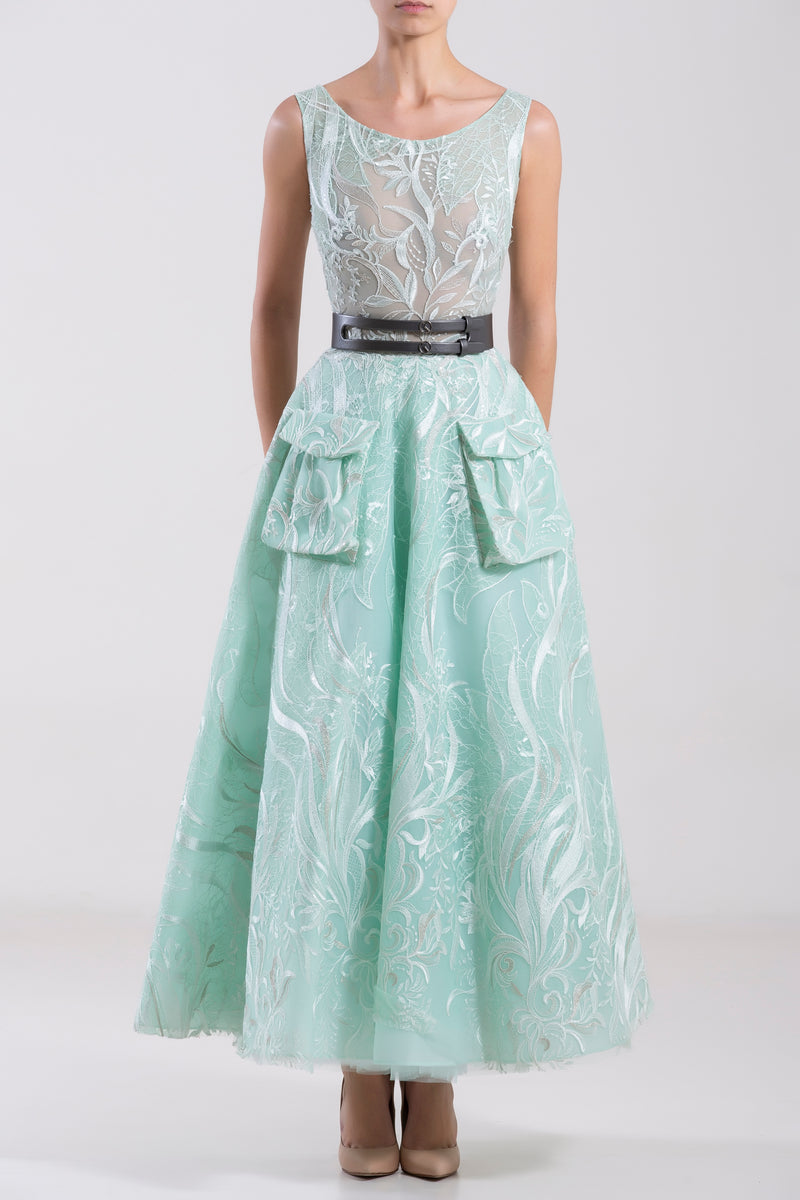 Short tulle embroidered, Blue Tint sleeveless dress with pockets, paired with a metallic grey leather belt.