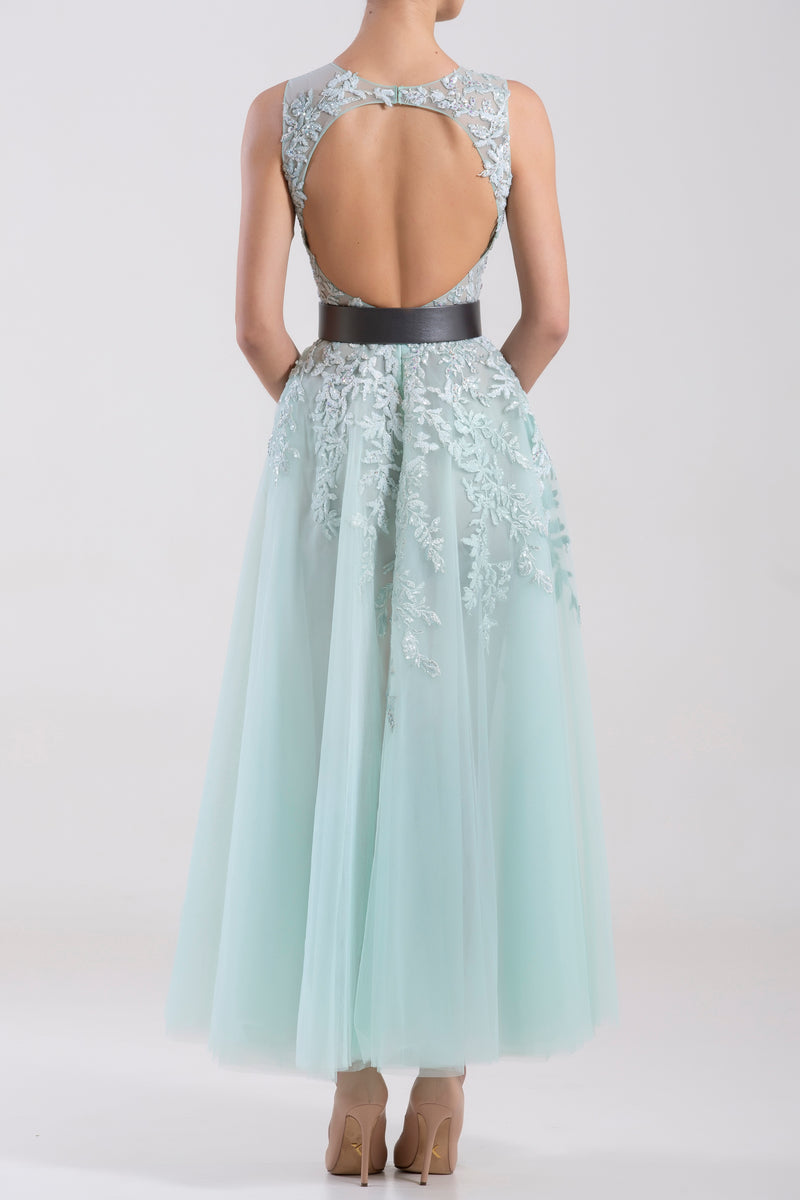 Short tulle embroidered, sleeveless dress paired with a metallic grey leather belt.