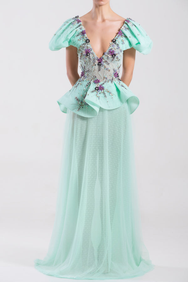 Long Blue Tint polka dot tulle dress with a beaded top and pleated peplum.