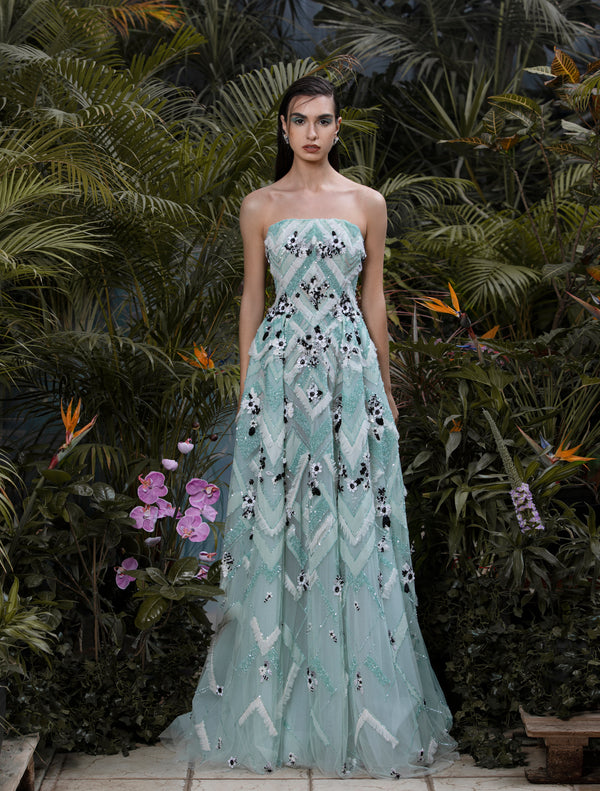 Long strapless fully beaded Blue Tint tulle dress.