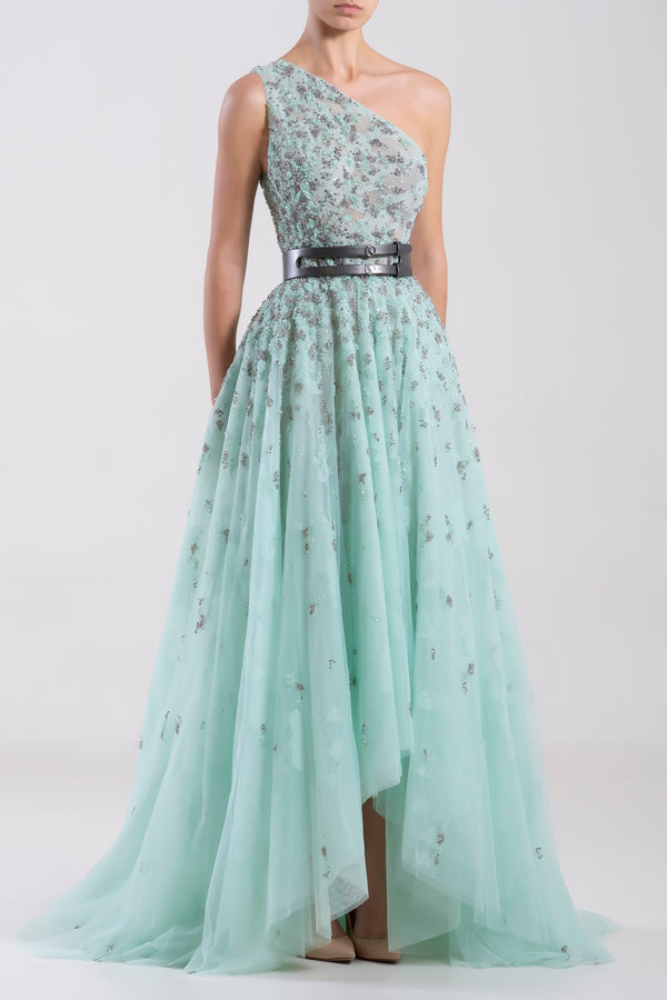 One shoulder Blue Tint tulle beaded, asymmetrical dress paired with a metallic grey leather belt.