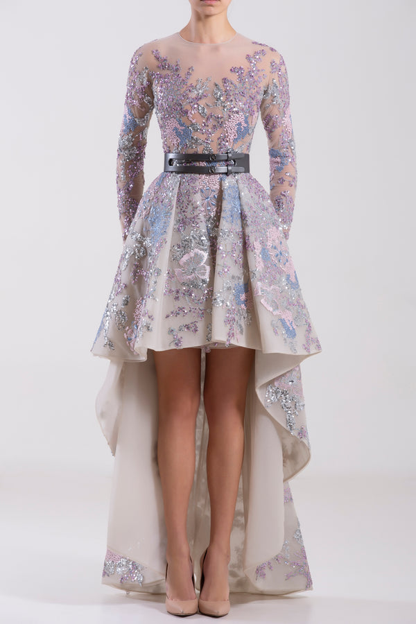High-low tulle embroidered dress with sleeves, paired with a metallic grey leather belt.