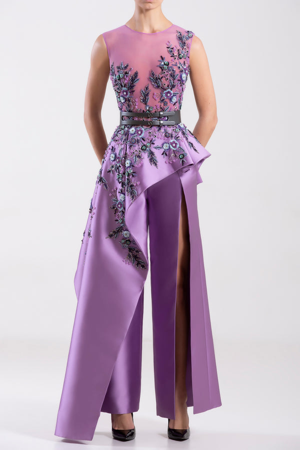Concord Grape Mikado, beaded jumpsuit with a side ruffle paired with a metallic grey leather belt.