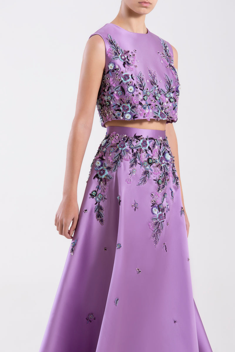 Short Concord Grape Mikado beaded top paired with a matching beaded Mikado skirt.
