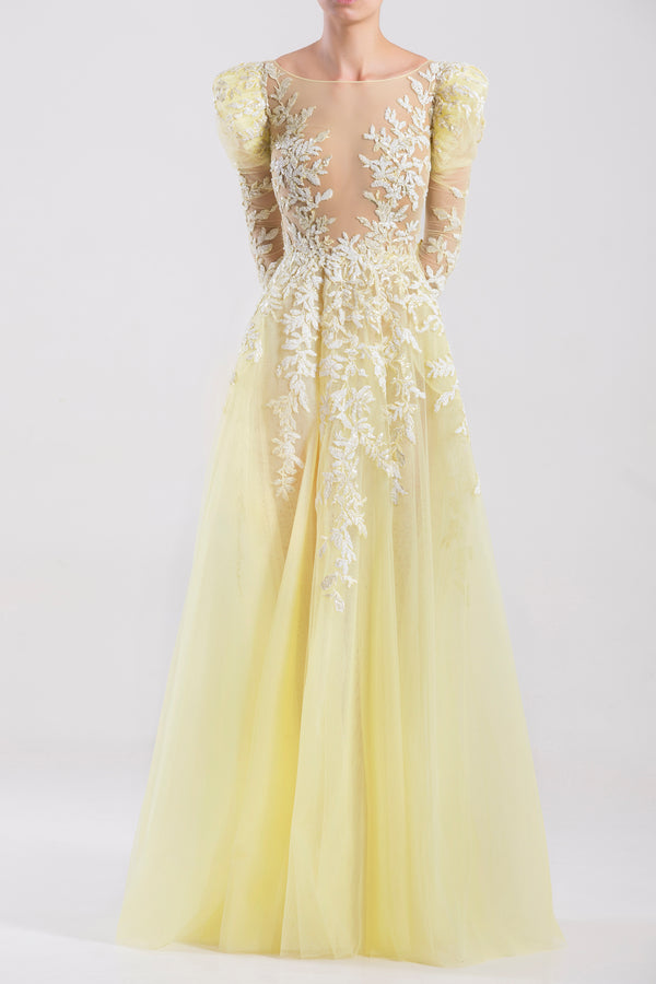 Long tulle embroidered Pastel Yellow dress with sleeves.