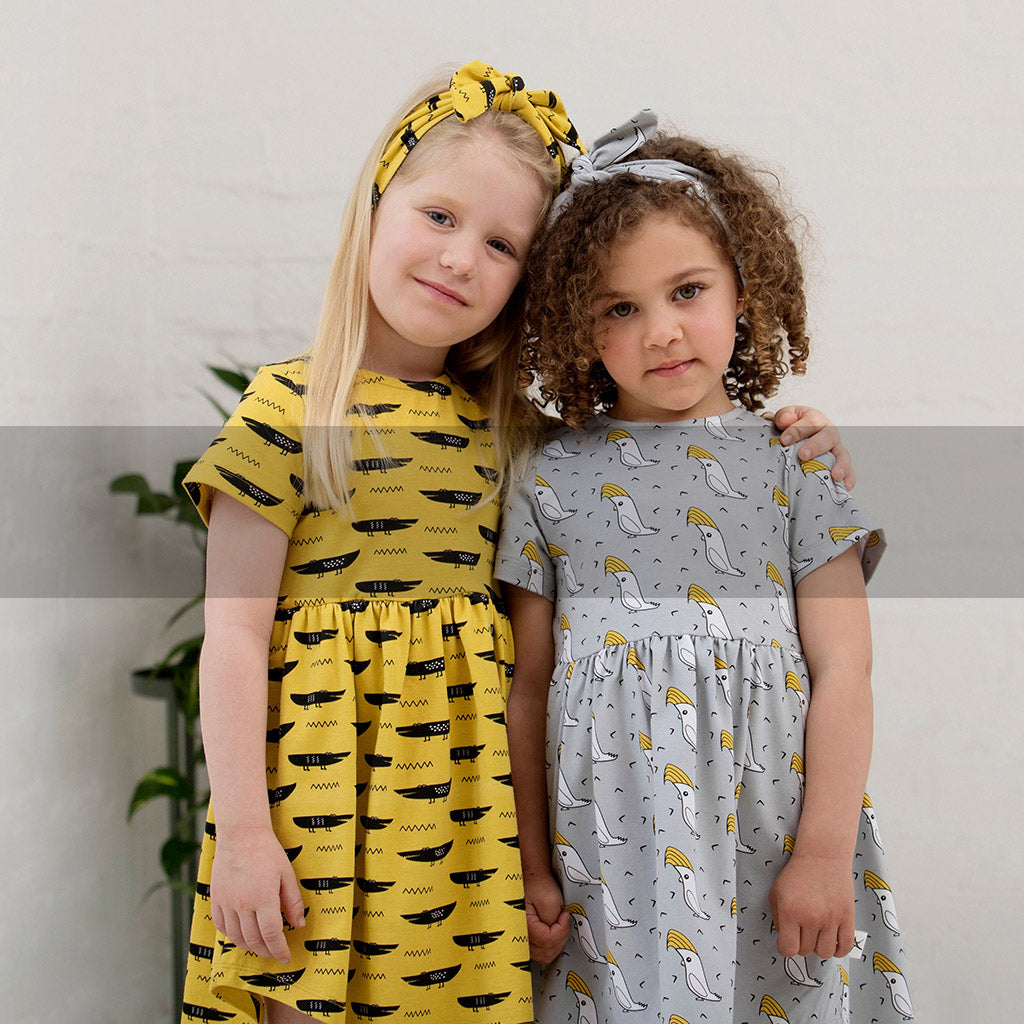 sustainable, organic girls clothing, dresses, overalls, t-shirts, headbands, scrunchies, skirts, shorts