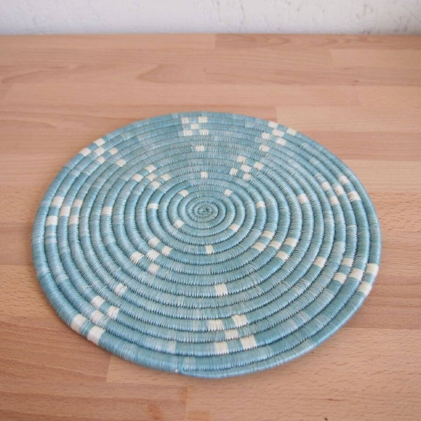 light blue african trivet on table