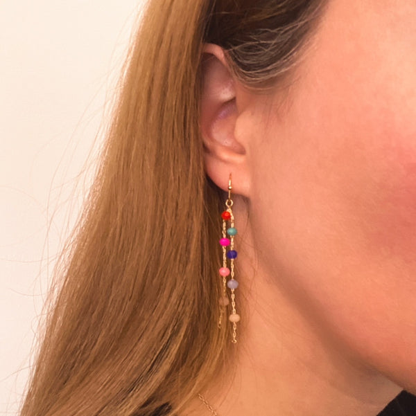 beaded dangly earrings on model