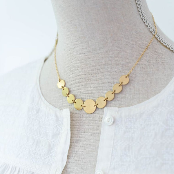 brass circle necklace on form image