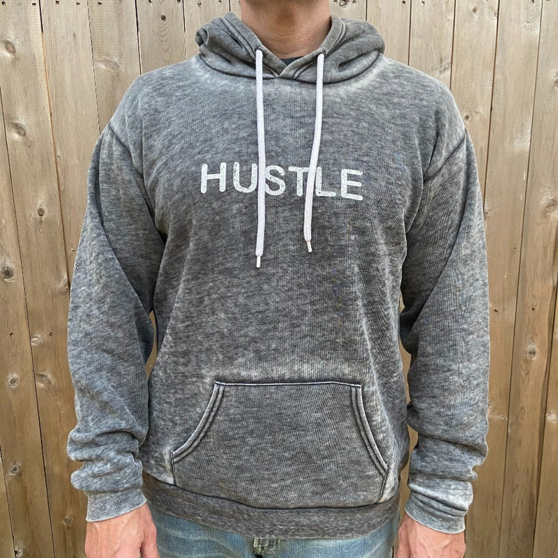 hustle unisex hoodie on man
