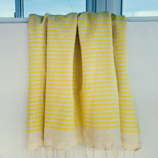 yellow and white turkish towel