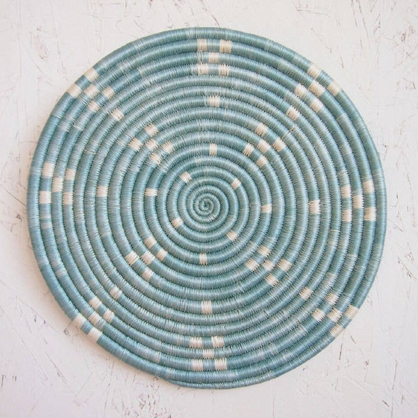woven african trivet in pale blue image