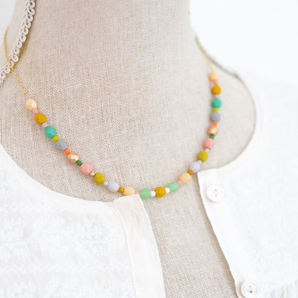 pastel beaded necklace on form