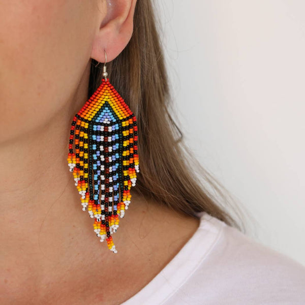 rainbow beaded earrings on model image