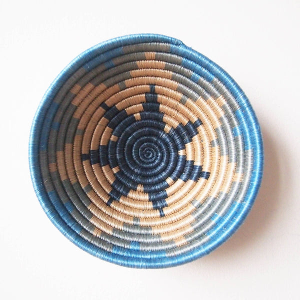 blue woven african basket with star