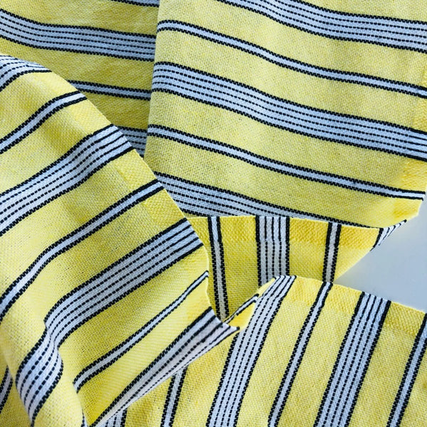 yellow and white striped turkish towel