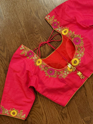 Red blouse with yellow floral work