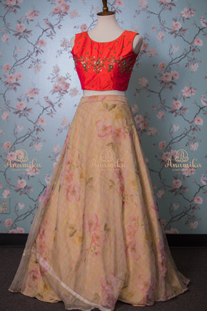 Orange raw silk work top with beige floral organza skirt