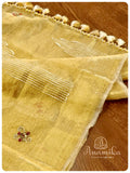 Classic gold tissue saree enhanced with hand work buttis