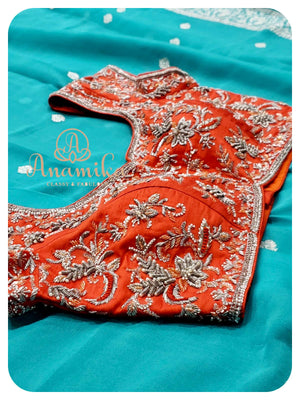 Blue banarasi chiffon with orange heavy work blouse
