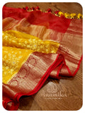 Yellow kora chikankari with red kanchi border