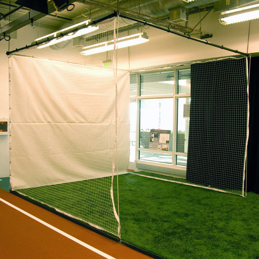 Golf cage suspended from the facility ceiling