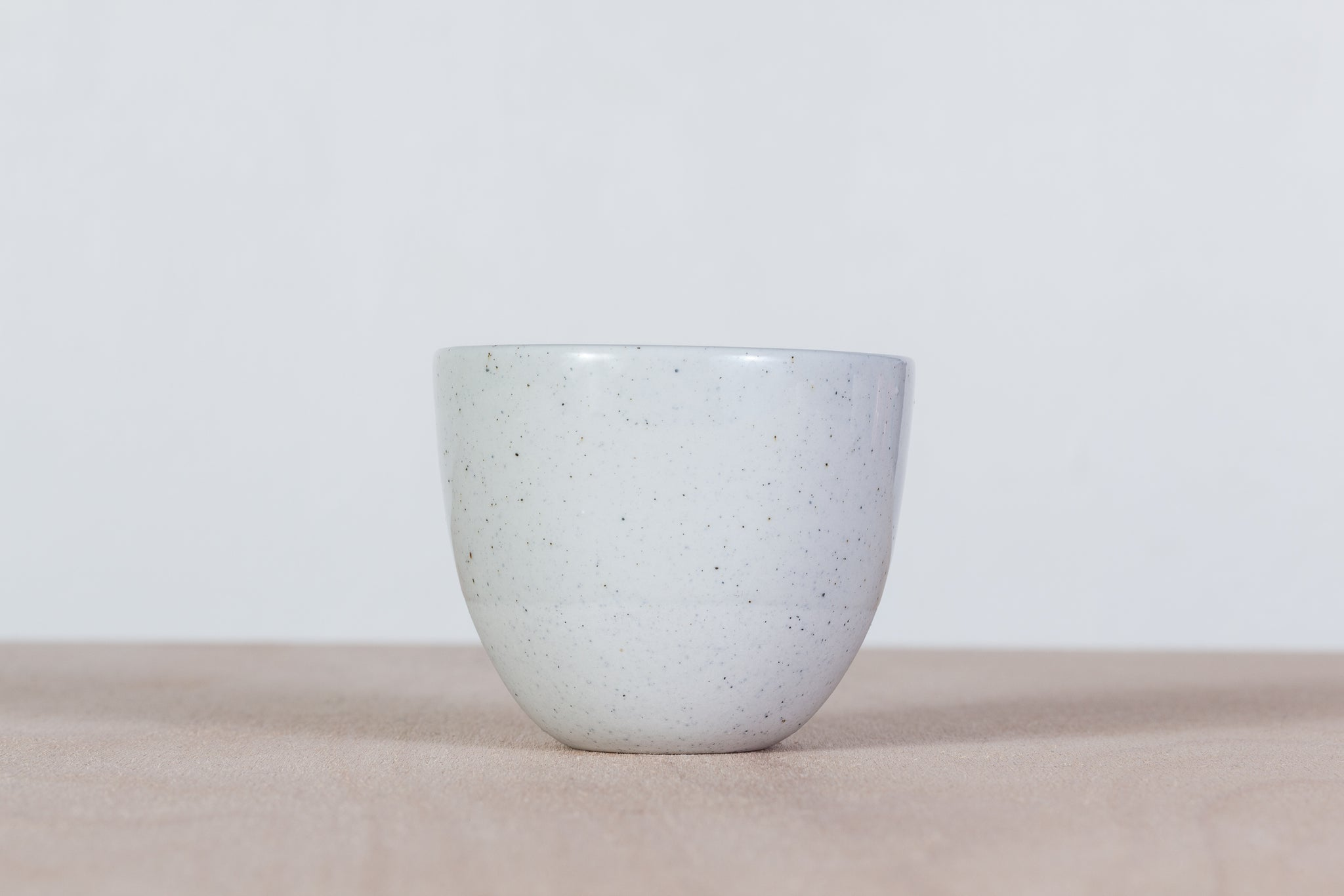 Simple gray cup with dots