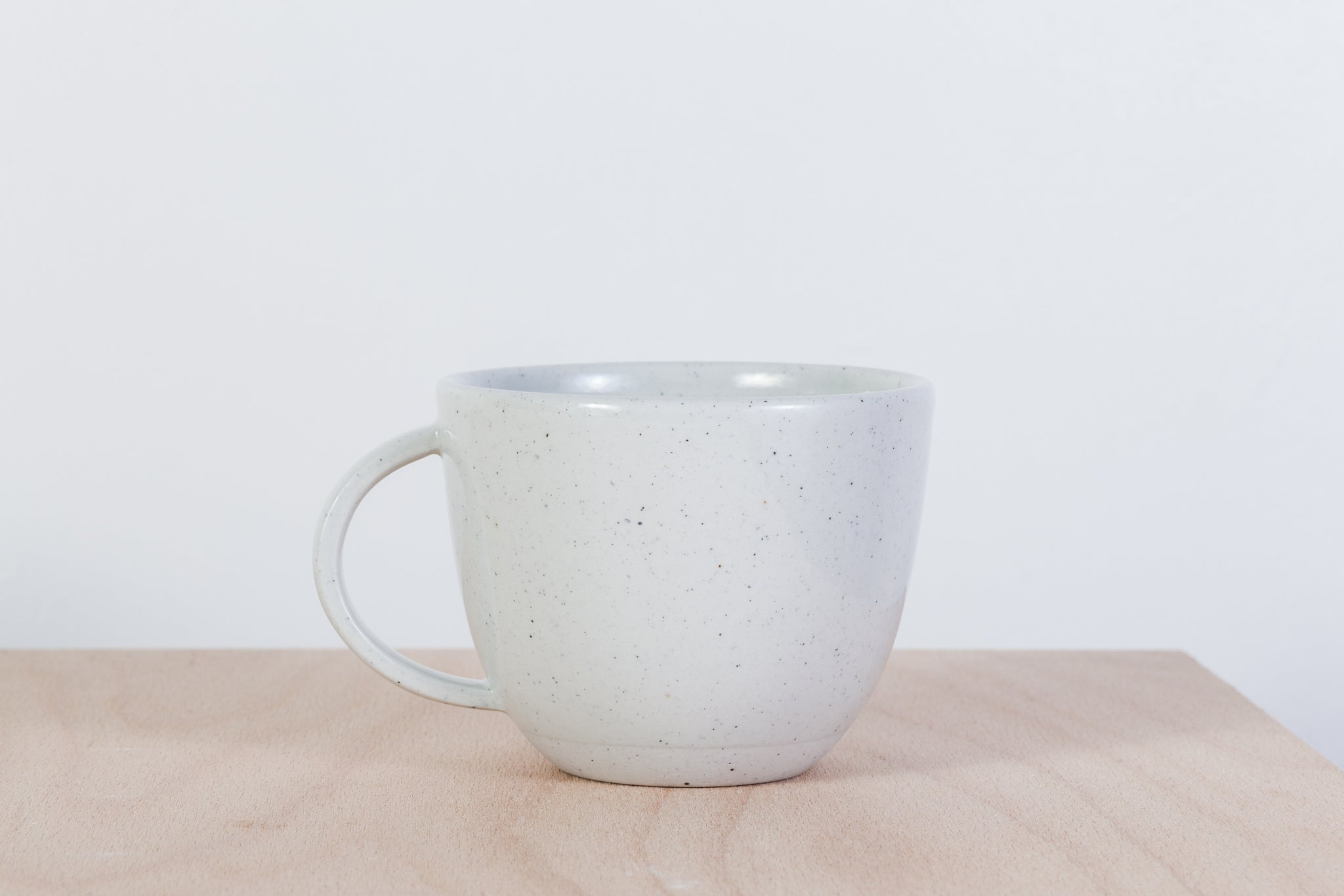 Simple gray mug with dots