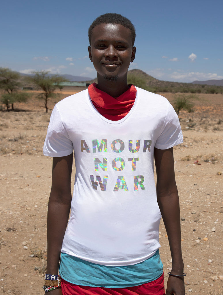 100% Non-Profit Holographic Slogan 'TREE HUGGER' Unisex T-Shirt designed by Sonya Rothwell x Temple Beautiful : Made in Heaven, hand printed in Britain to order on pure organic Fair Trade cotton with a stylish wide scoop neck : Modelled by Masai + Samburu Warriors, Kenya