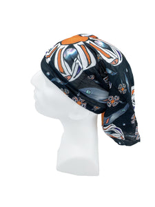 Orange & Black Story Headwear by Brenda Lee Asp