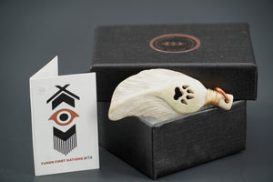 Feather Pendant with Wolf Paw by Dennis Shorty