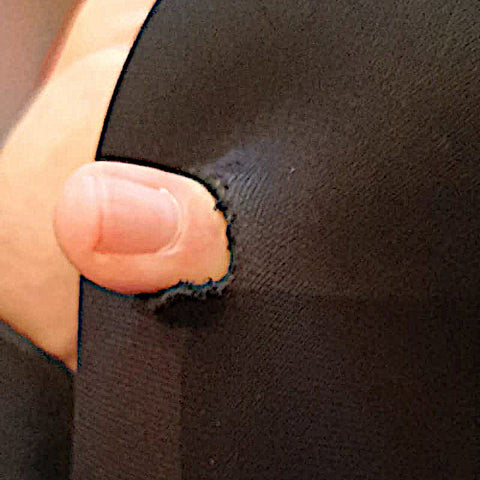 Winter wetsuit with a finger passing through a hole