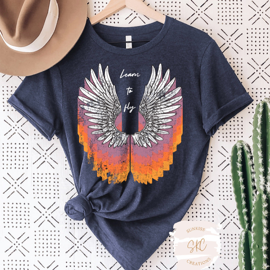 Learn to Fly Wings Tee - SKC Boutique