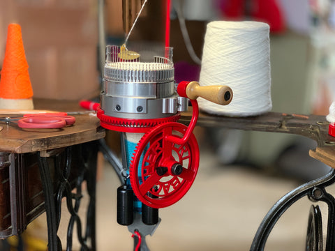 The design of the hand-cranked knitting machine we use to make Swizzle Socks dates back centuries