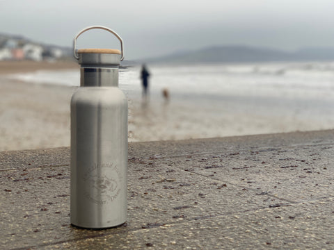 Buy a reusable bottle to help cut down on using plastic.
